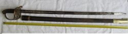 The Old British Colonial Saber plus Scabbard is a good condition blade length 32 1/4 inches. The hilt handle has a brass including royal crown letters